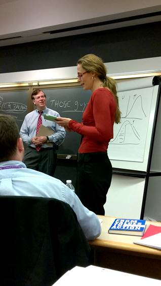 "Rachel Audige delivering the ""Kraemer Leadership Oath"""