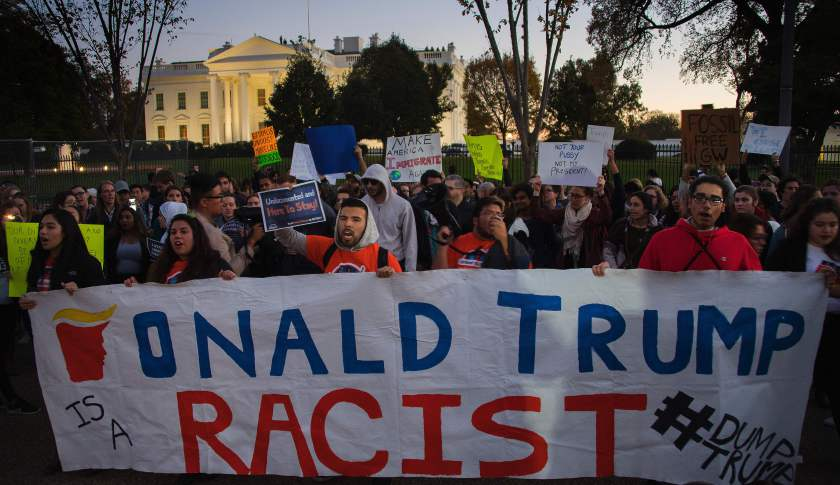 Anti President-elect Donald Trump protesters chant outside the White House in Washington, DC, November 10, 2016. Protesters burned a giant orange-haired head of Donald Trump in effigy, lit fires in the streets and blocked traffic as rage over the billionaire's election victory spilled onto the streets of major US cities. / AFP / JIM WATSON        (Photo credit should read JIM WATSON/AFP/Getty Images)